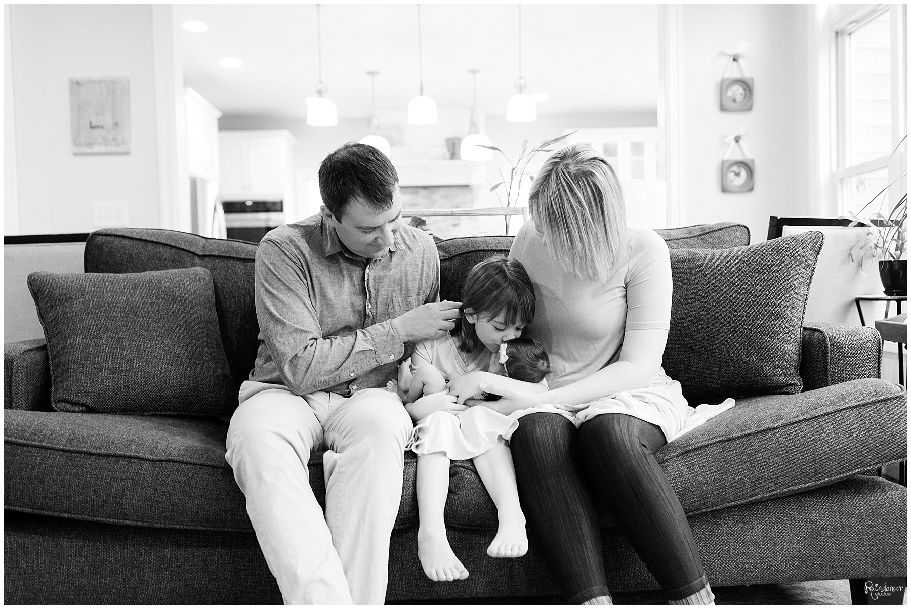 Indiana Newborn Photographer visits Bloomington home for a lifestyle family newborn session.