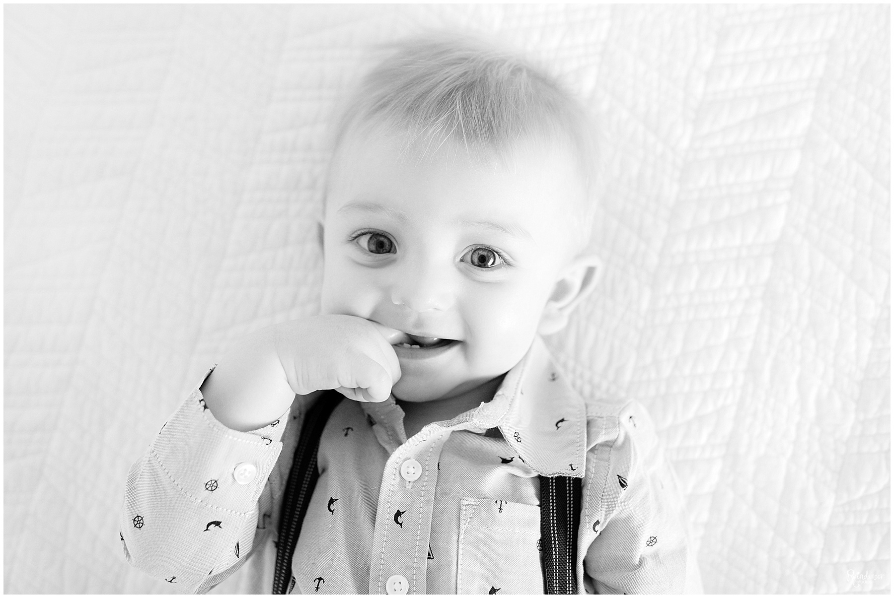One year old boy with his finger in his mouth by Raindancer Studios Indianapolis Family Photographer Jill Howelll