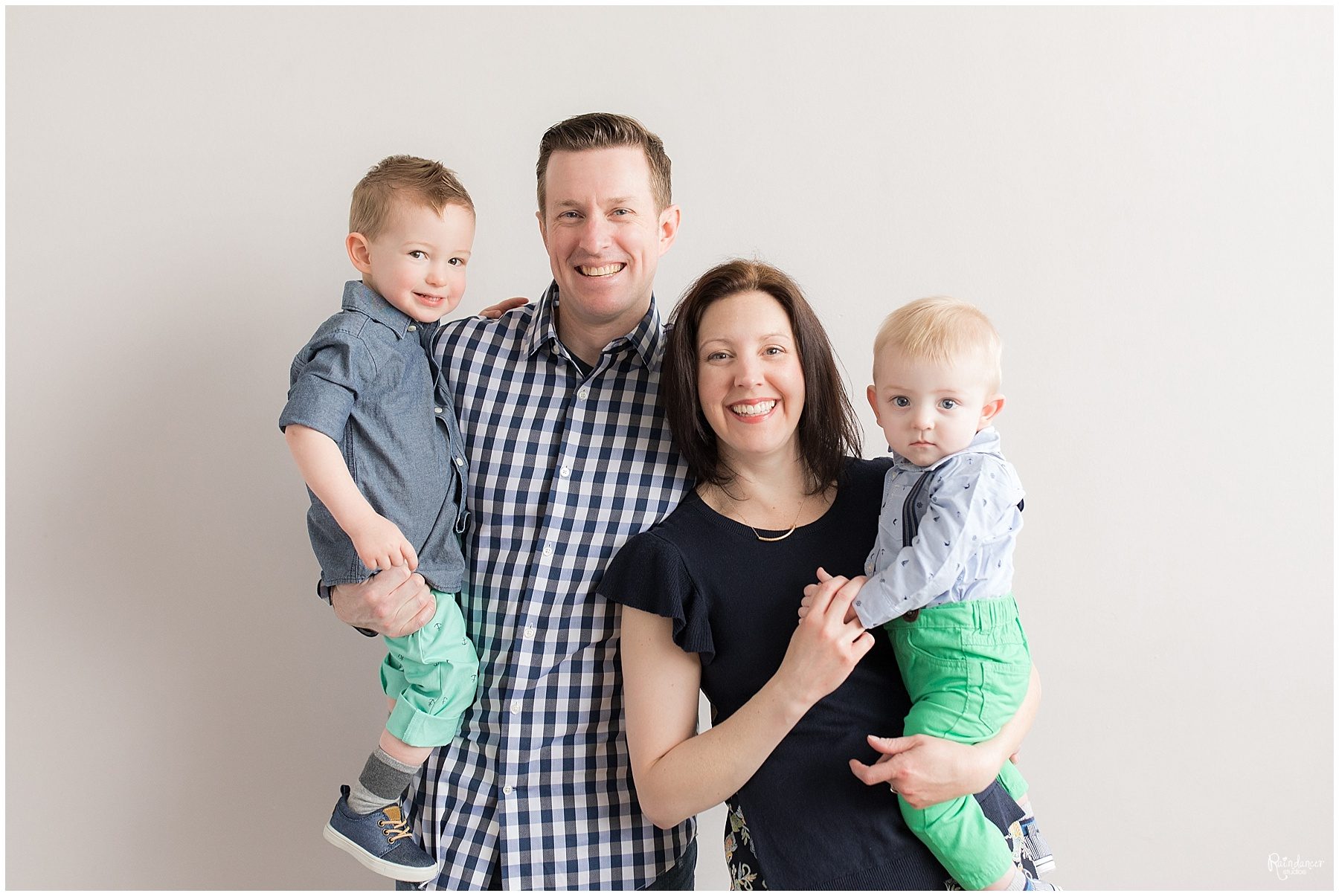 Parents holding two sons and smiling by Raindancer Studios Indianapolis Family Photographer Jill Howelll