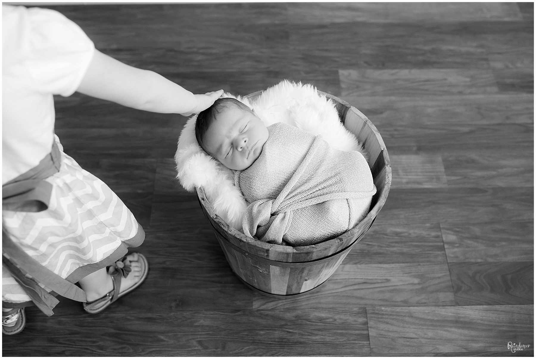 Big sister touching newborn baby brothers head by Raindancer Studios Indianapolis Newborn Photographer Jill Howell