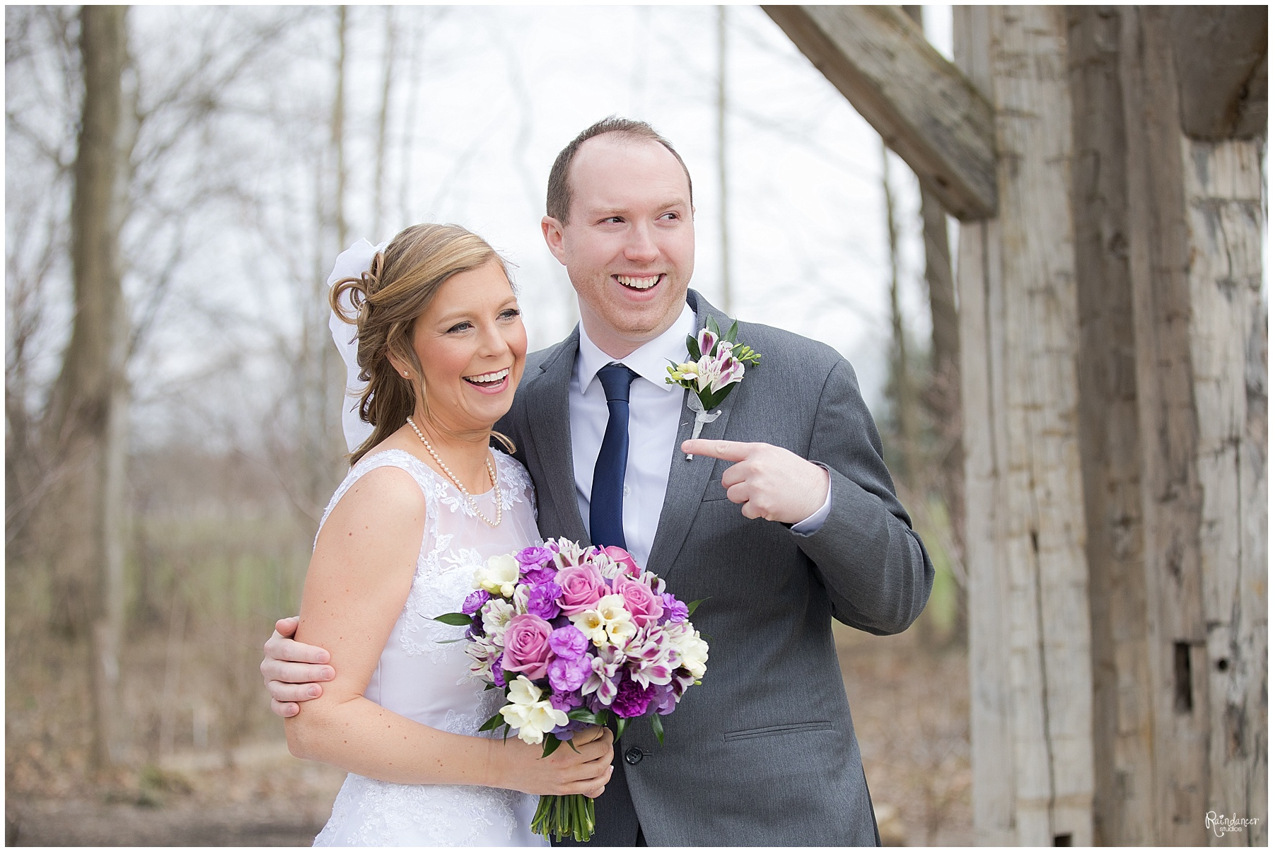 Groom pointing at his new wife Raindancer Studios Indianapolis Wedding Photographer Jill Howell
