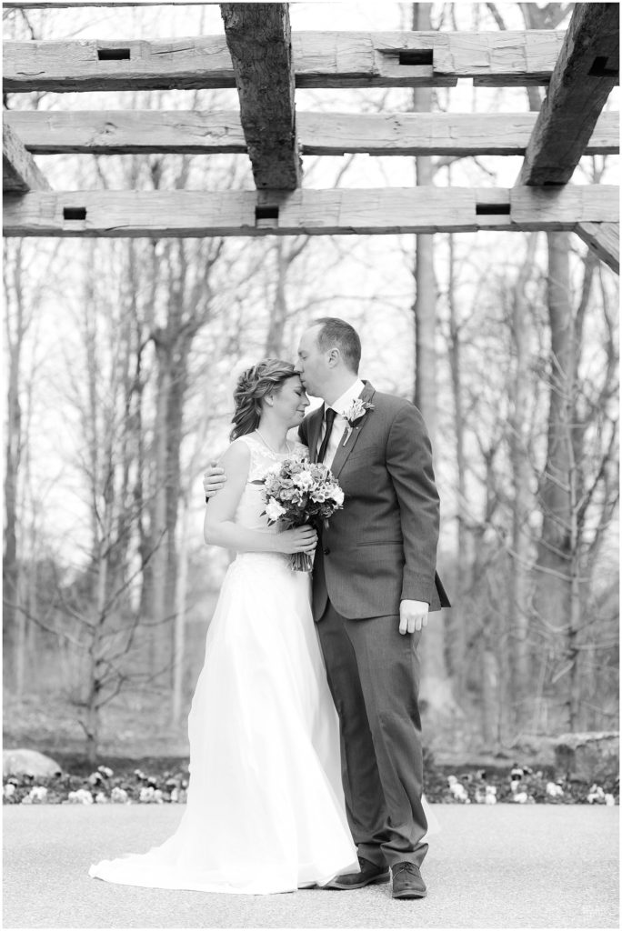 Groom kissing brides forehead by Raindancer Studios Indianapolis Wedding Photographer Jill Howell