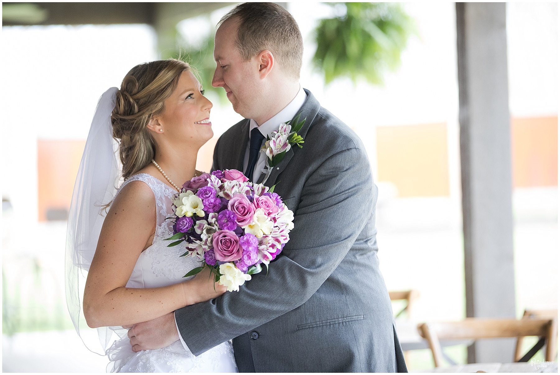 Bride and groom hugging by Raindancer Studios Indianapolis Wedding Photographer Jill Howell