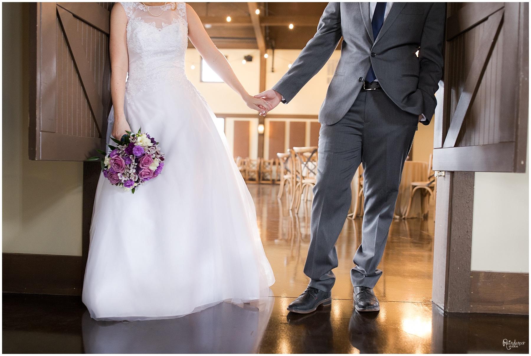 Bride and groom holding hands in a doorway by Raindancer Studios Indianapolis Wedding Photographer Jill Howell