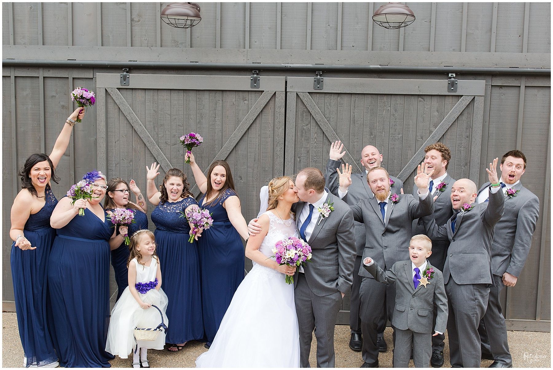 Bride, groom, and wedding party posing by Raindancer Studios Indianapolis Wedding Photographer Jill Howell