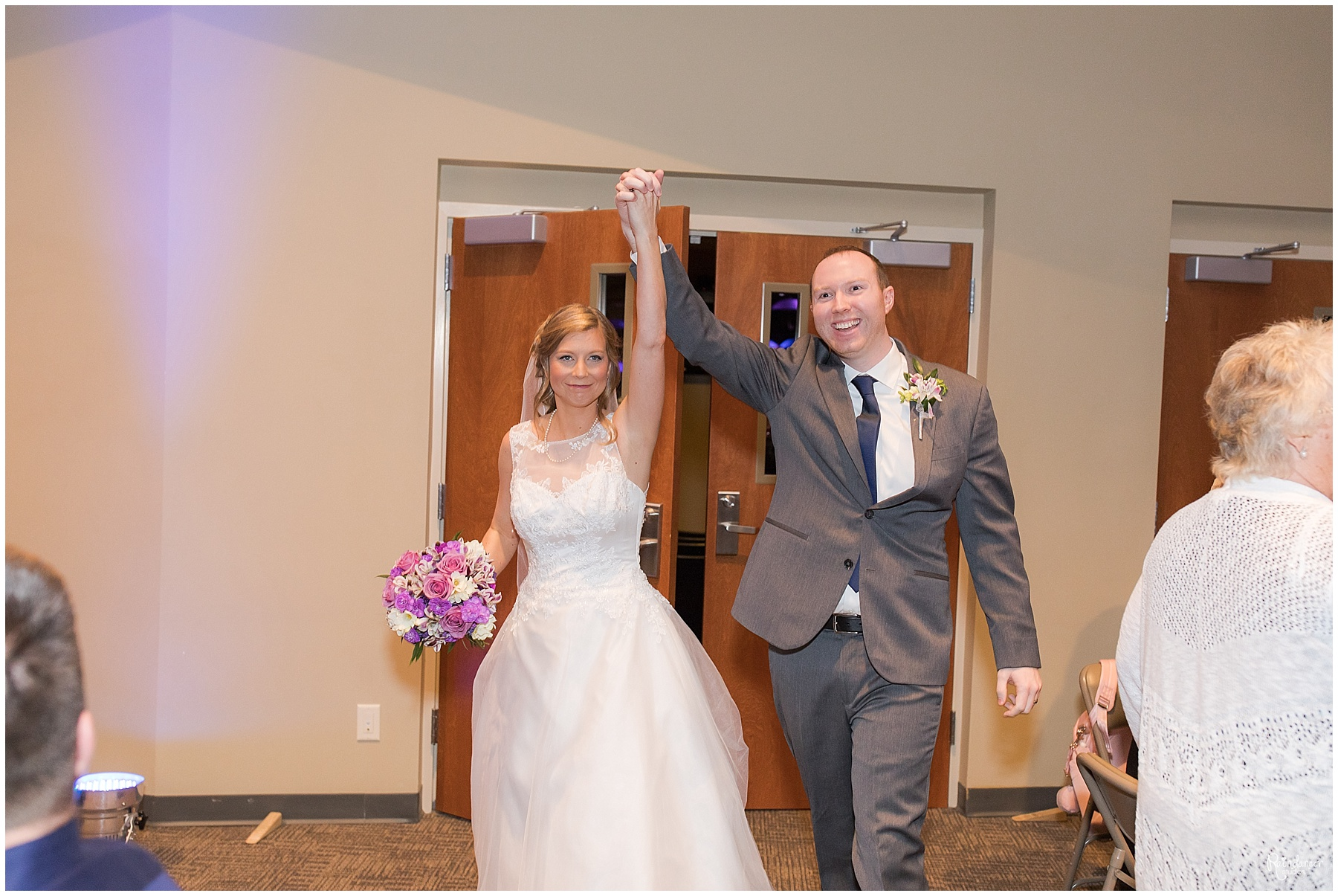 Bride and groom entering after the ceremony by Raindancer Studios Indianapolis Wedding Photographer Jill Howell