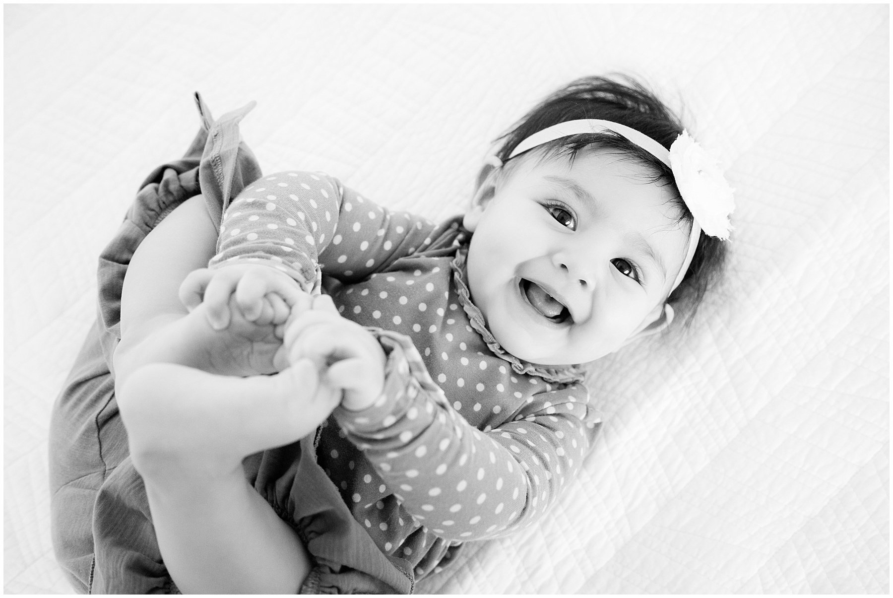 Six month baby girl playing with feet. Indianapolis Baby Photographer