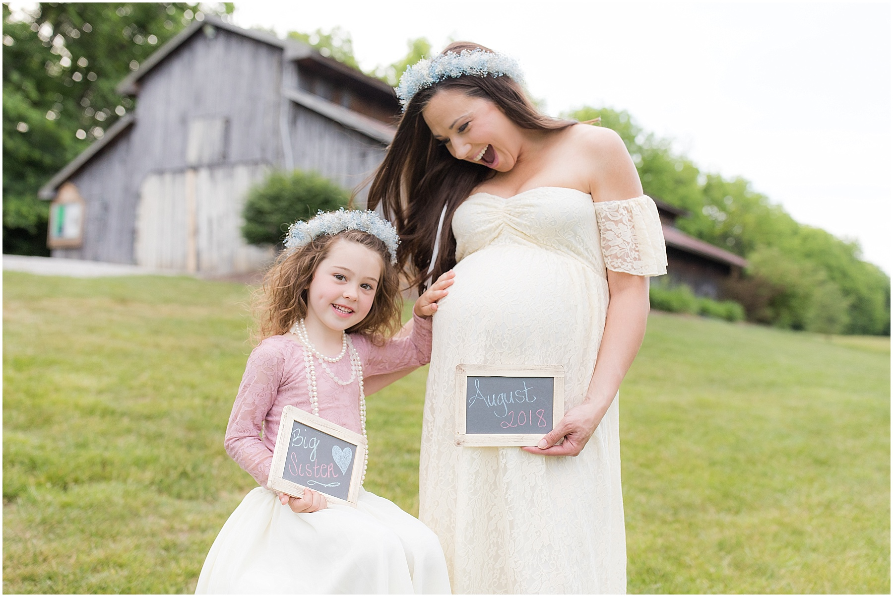 Mother and her little girl excited about baby sister coming in August