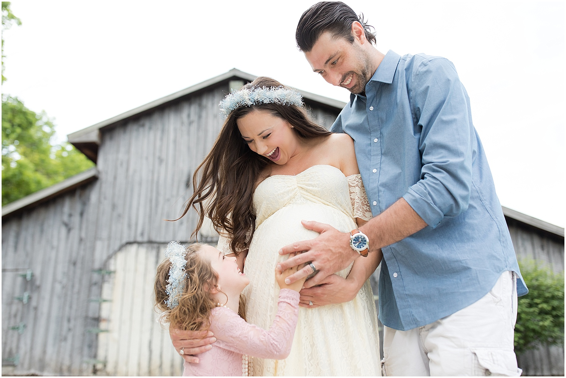 Father and daughter holding mothers belly, celebrating their soon to be second daughter - Indianapolis Maternity Photography