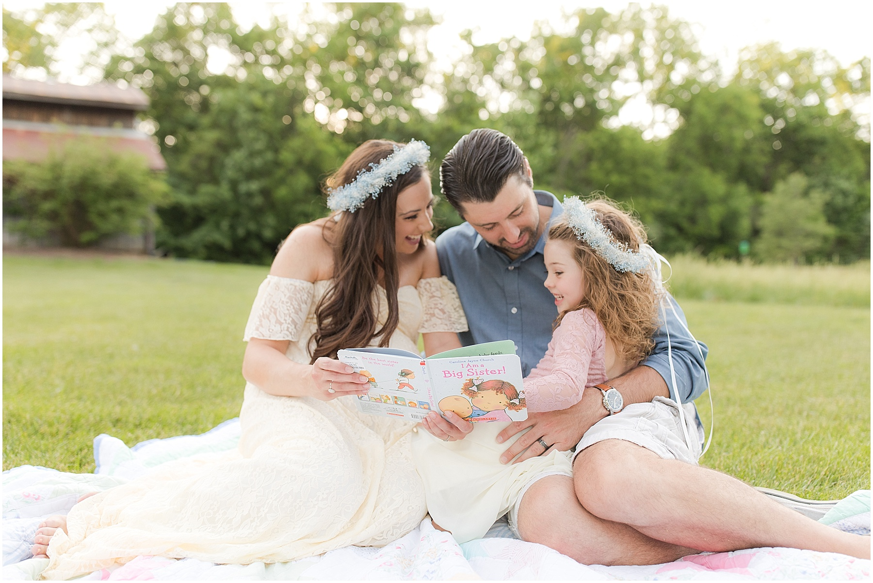Parents reading to their daughters in the field, Indianapolis Maternity Photography