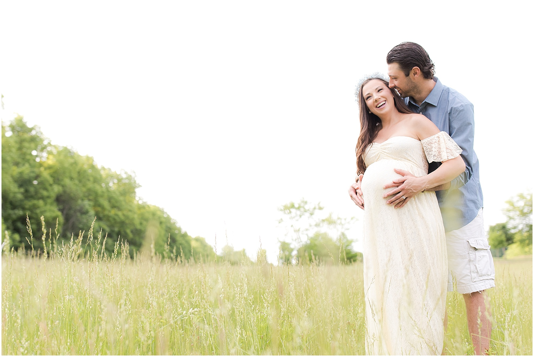 Husband kissing expecting wife in the fields, Indianapolis Maternity Photography