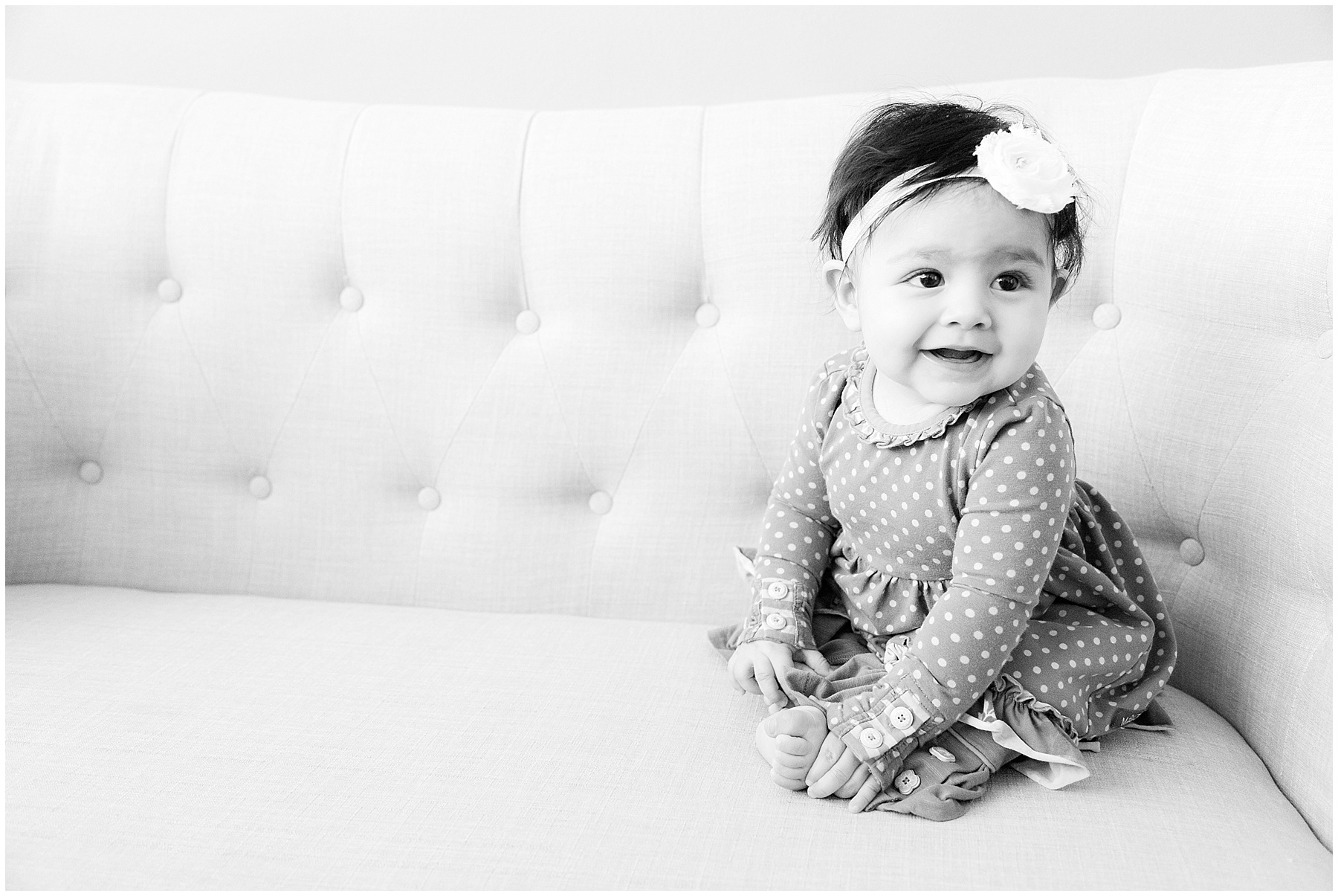 6 month old baby girl on couch holding toes. Indianapolis Baby Photographer