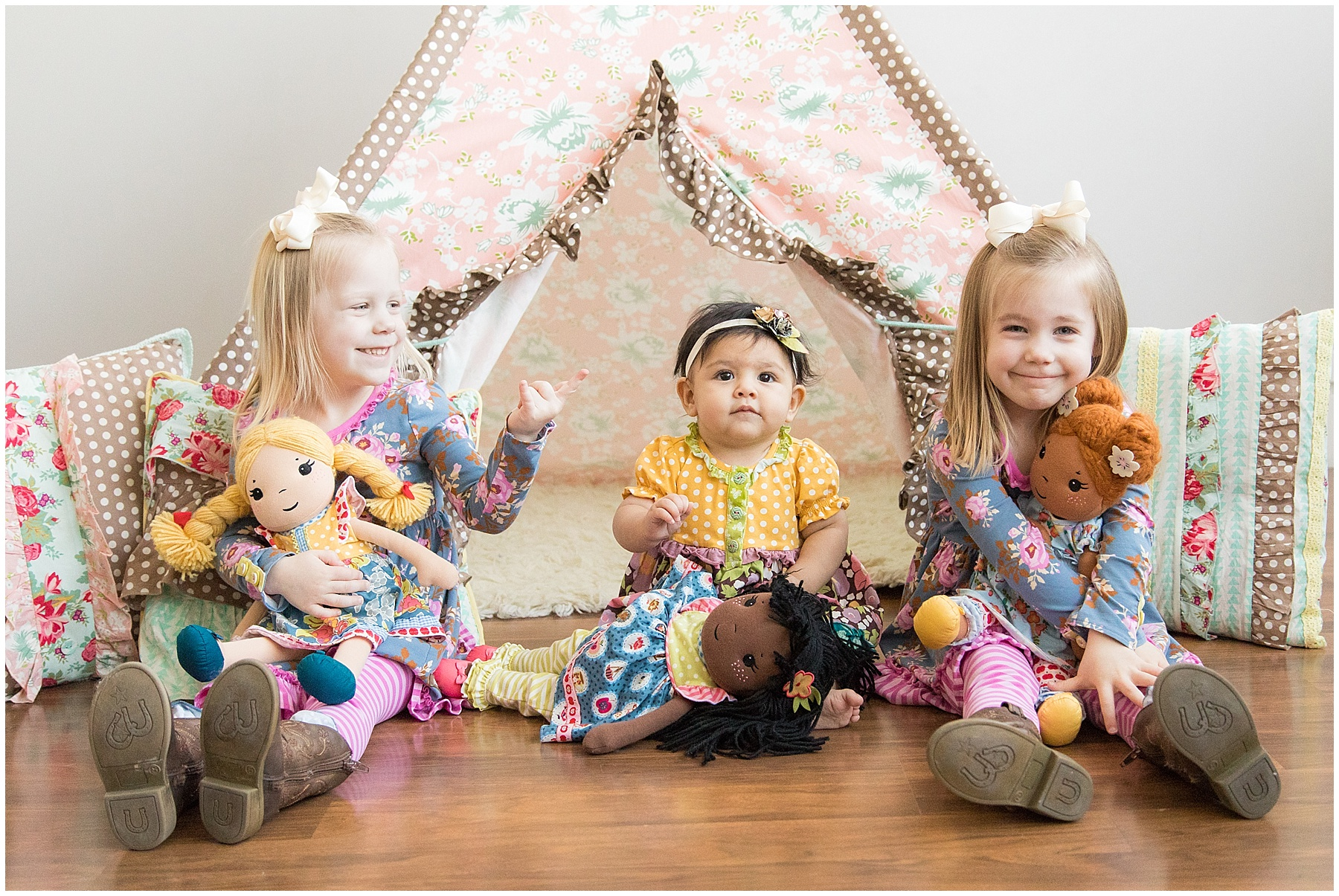 Three sisters sitting by teepee with their dolls. Indianapolis Children Photographer