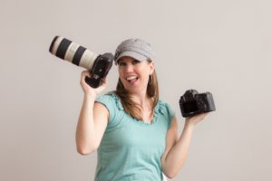 Indianapolis photographer, Jill Howell, holding a Canon 5D Mark iv and Canon 5D mark iii in her hands.