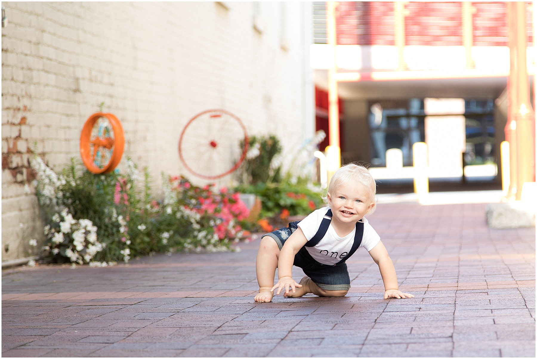 One year old boy crawling in alley way, Columbus Family Photography, Raindancer Studios