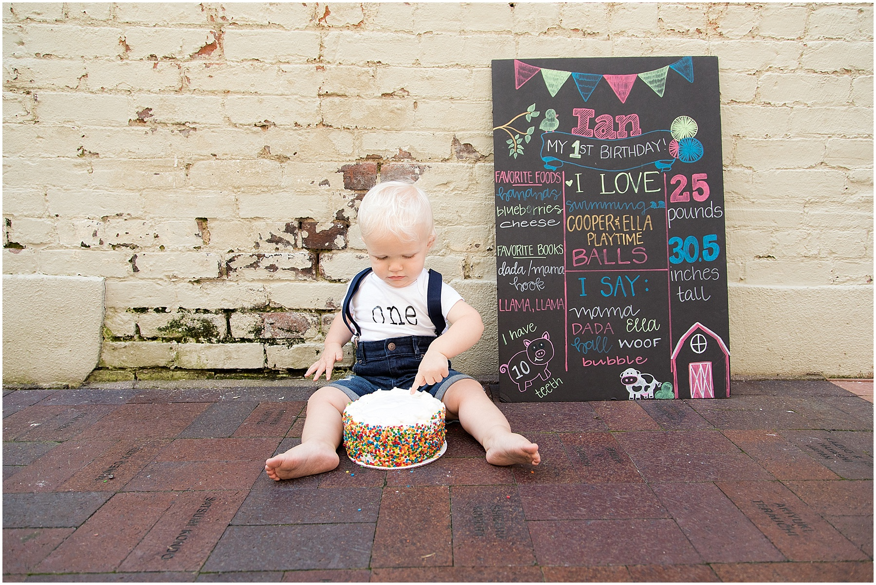 Little boy celebrating being one years old with smash cake, Columbus Family Photography, Raindancer Studios