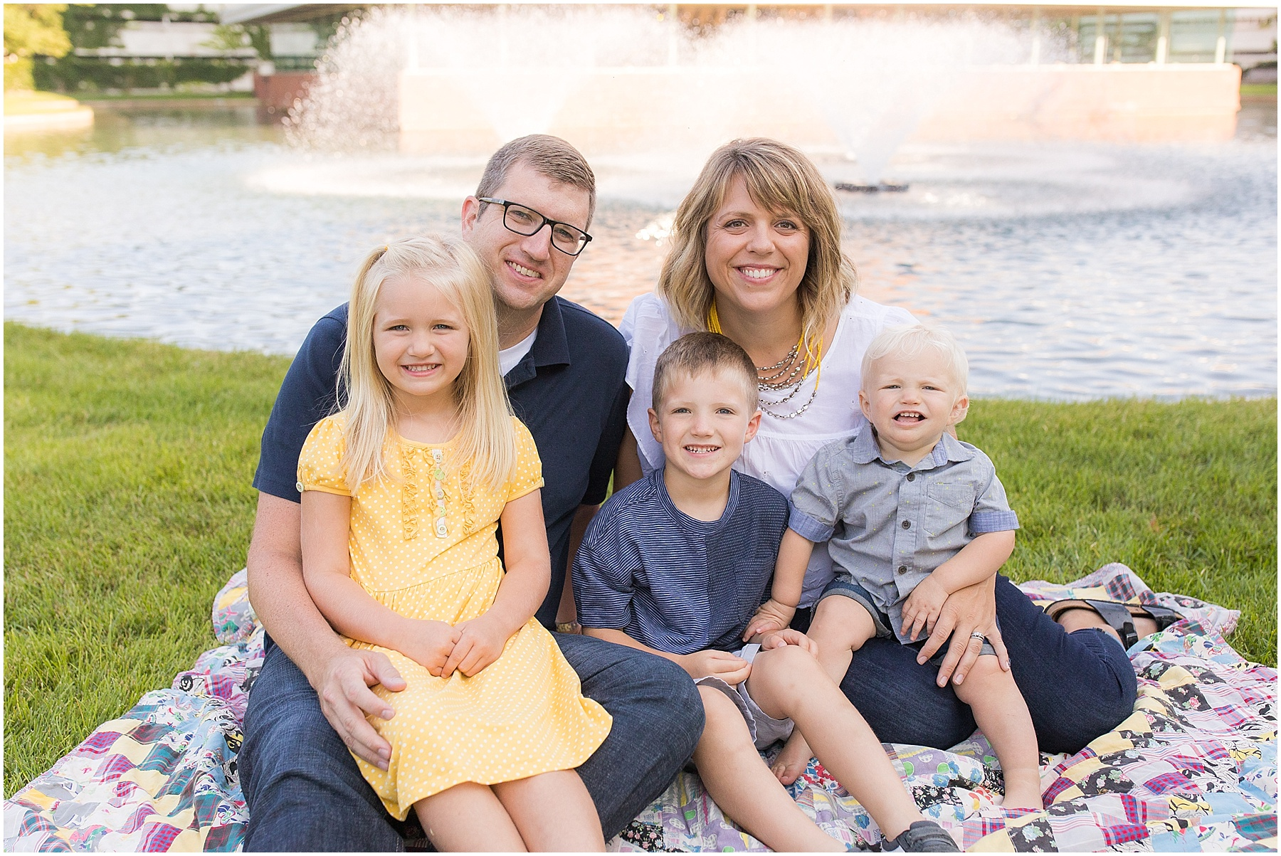 Family of 5 posing in front of water fountain, Columbus Family Photography, Raindancer Studios