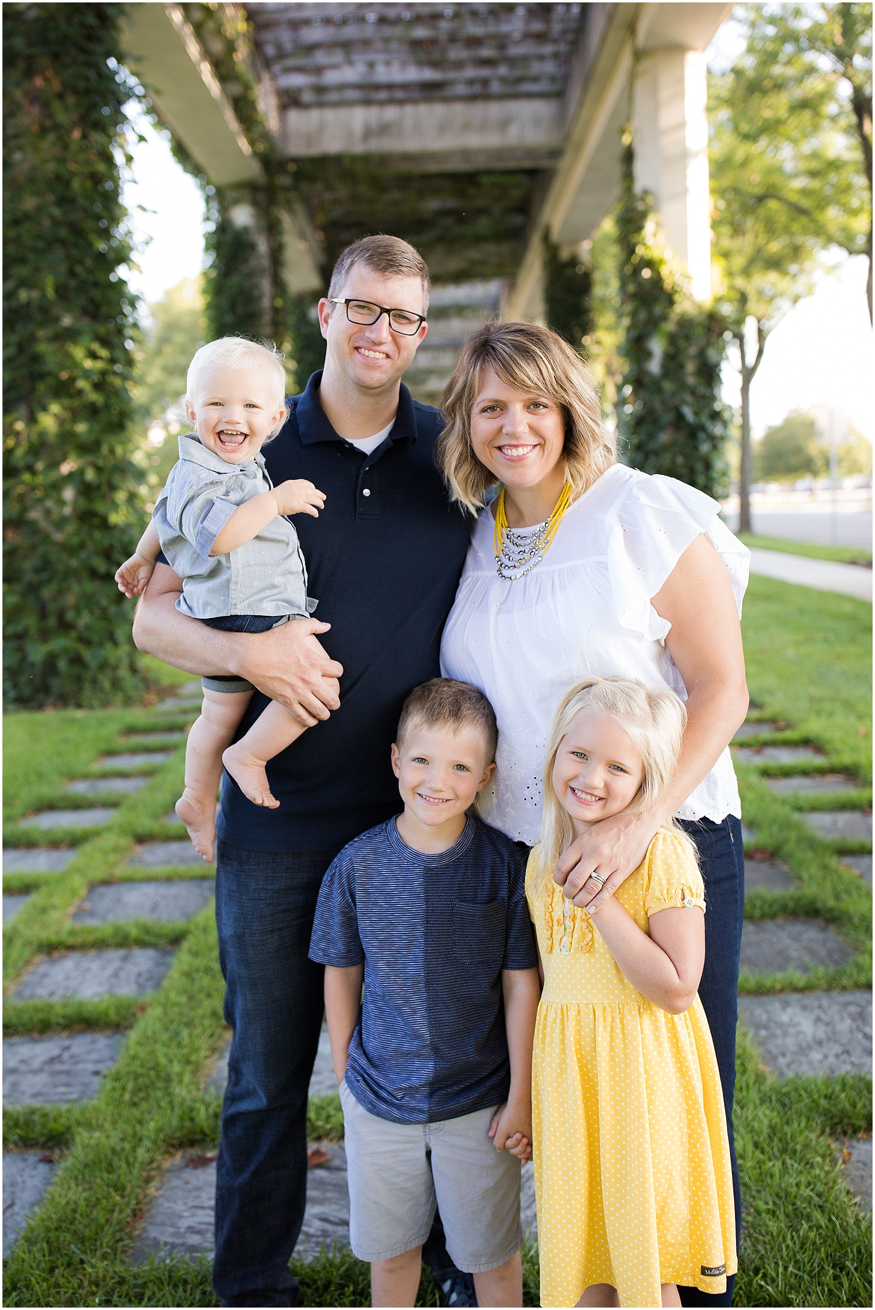 Parents holding their three children, Columbus Family Photographer, Raindancer Studios