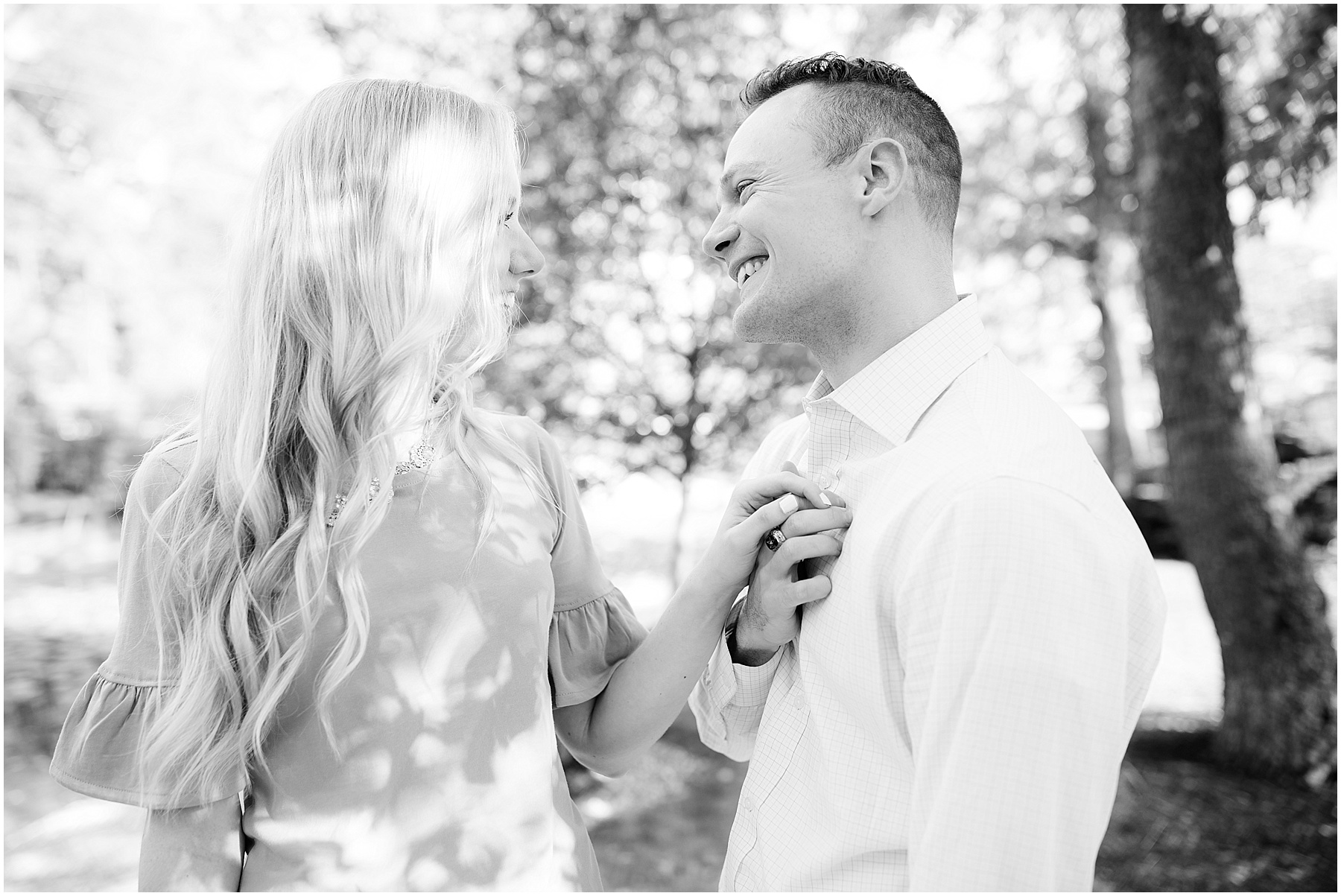 Future spouse holding his soon to be wife's hand to his chest, Indianapolis Engagement Photographer, Raindancer Studios