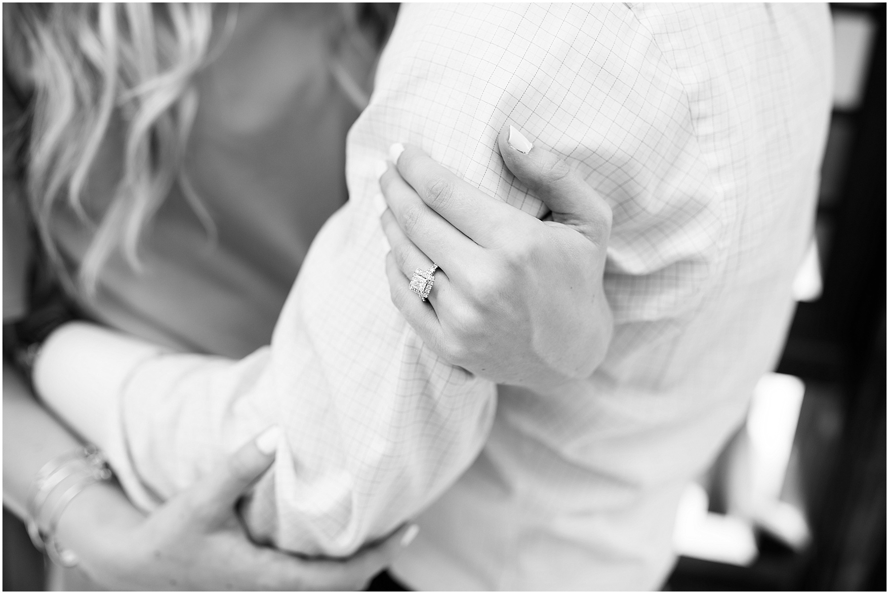 Fiance' holding soon to be husband arm. Indianapolis Engagement Photographer, Raindancer Studios
