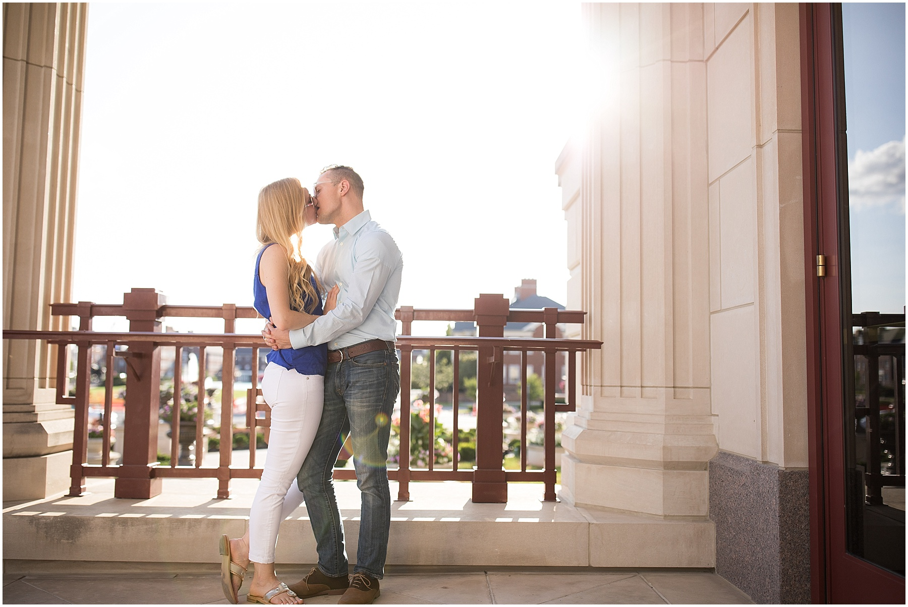 Two love birds kissing with the sunset in the background, Indianapolis Engagement Photographer, Raindancer Studios