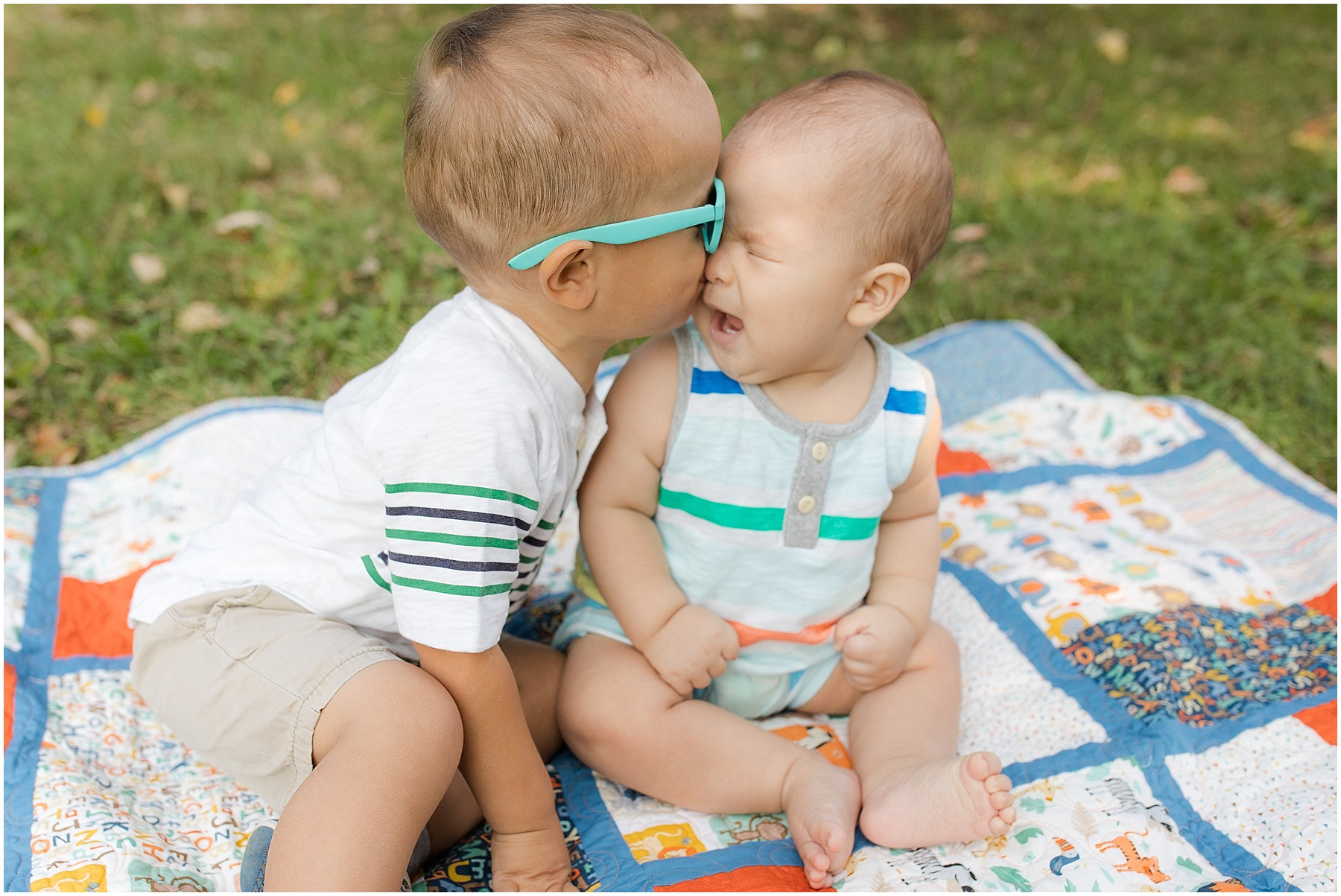 Brotherly love, kissing sister.  Indianapolis Family Photography, Raindancer Studios