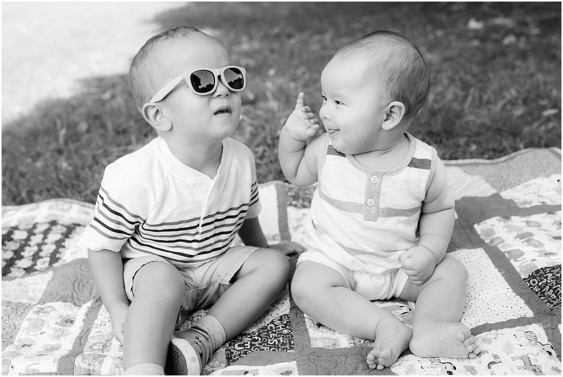 Baby sister intrigued by big brothers sunglasses.  Indianapolis Family Photography, Raindancer Studios