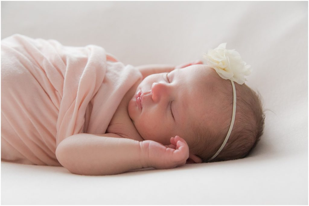 Newborn girl swaddled in light pink blanket. Indianapolis Baby Photographer