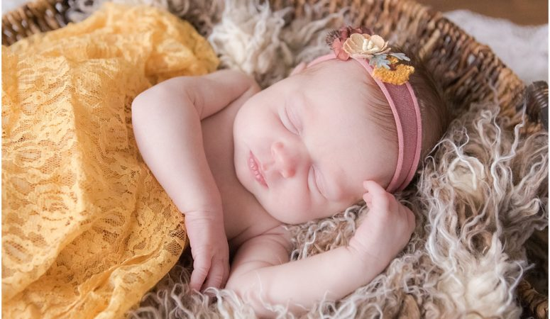 Newborn girl swaddled in yellow blanket. Indianapolis Newborn Photography