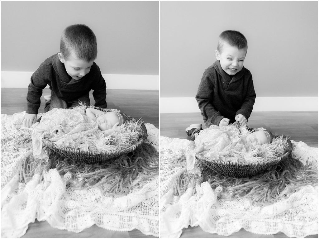 Brother with baby sister laying in basket. Taken by Indianapolis Newborn Photographer