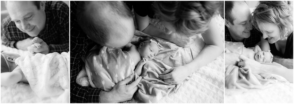 Parents looking at baby girl swaddled in blanket. Indianapolis Baby Photographer